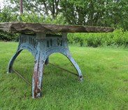 Side view of the garden antique york stone table top on the cast iron base
