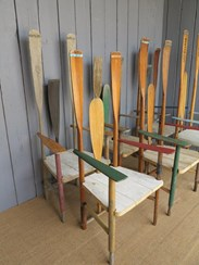 Side view of the set of 6 rowing them chairs