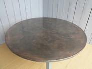 Showing the patina of the copper topped table