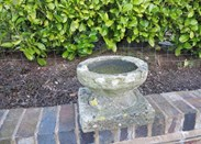 Showing the top of the Hand Carved Stone Garden Birdbath