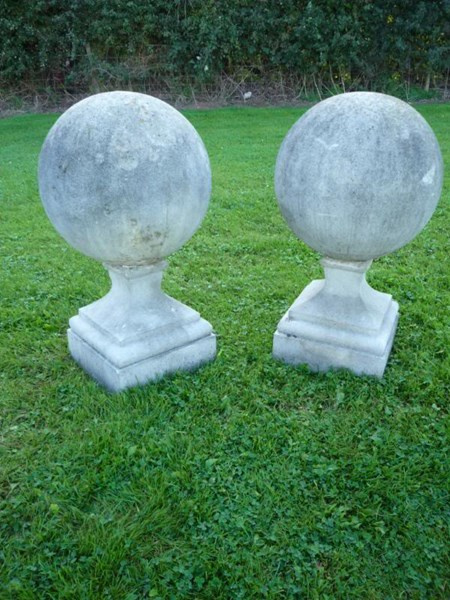 A pair of antique composition stone gate pier ball finials