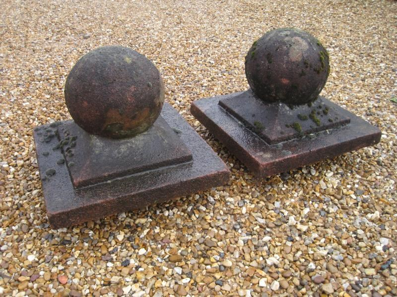 A pair of Weathered Stone Gate Pier Finials