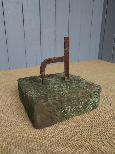 A Wrought Iron Boot Scraper on Stone Base