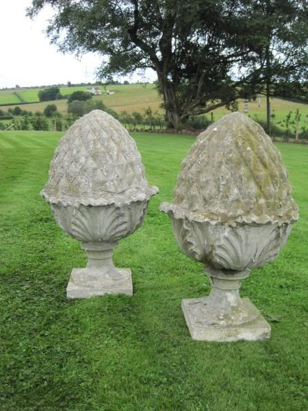 A pair of Austin and Seeley composition stone pineapple finials