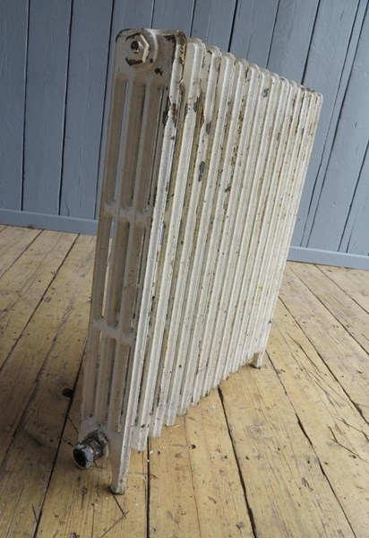 Showing the side of the reclaimed cast iron radiator 4 columns deep