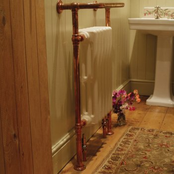 Cast iron bathroom heated towel rails in many styles