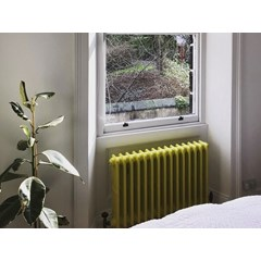 Yellow Victorian Style Cast Iron Radiator