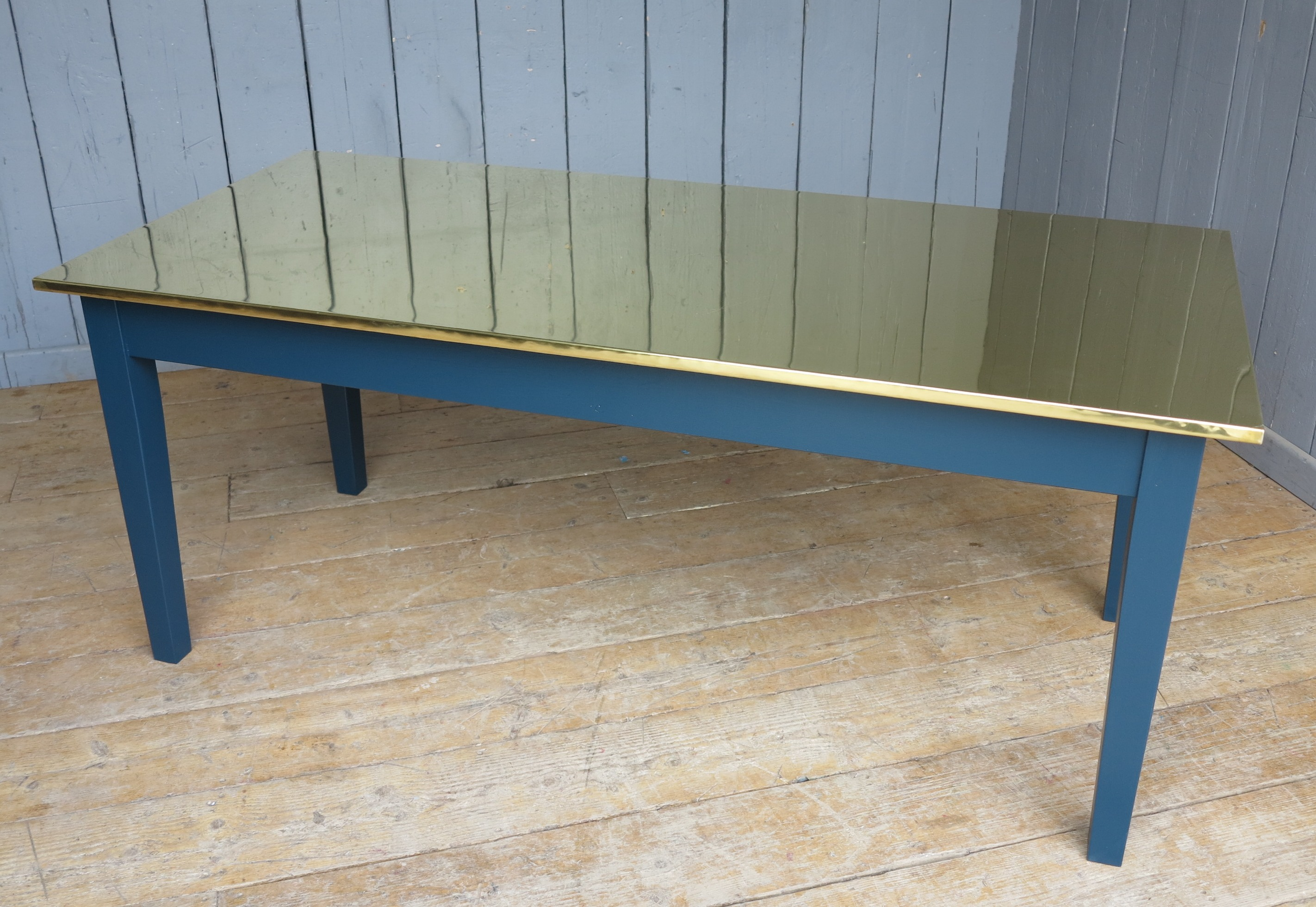 bespoke brass table made by hand at UKAA to individual specifications and requirements. Table base painted in Farrow and Ball Hague Blue.