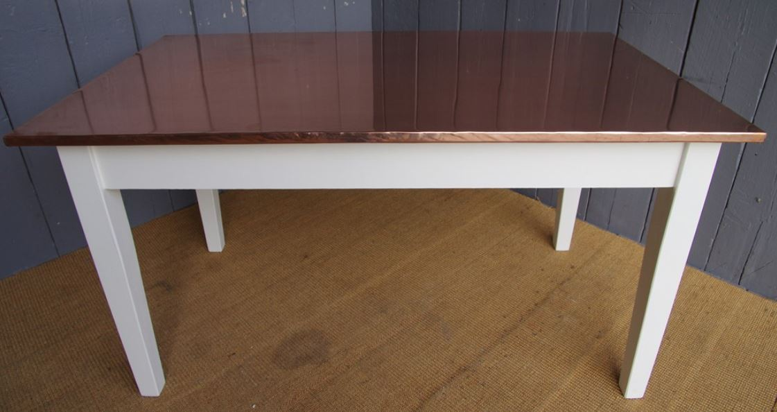 copper top bespoke and made to measure tables at UKAA made by our skilled onsite joiners.