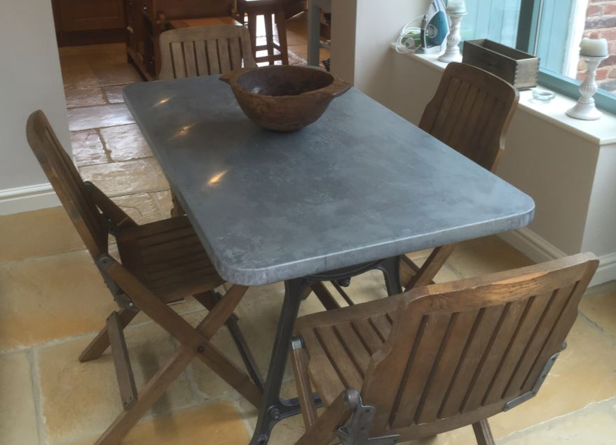 Bespoke zinc natural metal topped table made by hand at UKAA by our team of skilled joiners with a reclaimed antique cast iron painted base