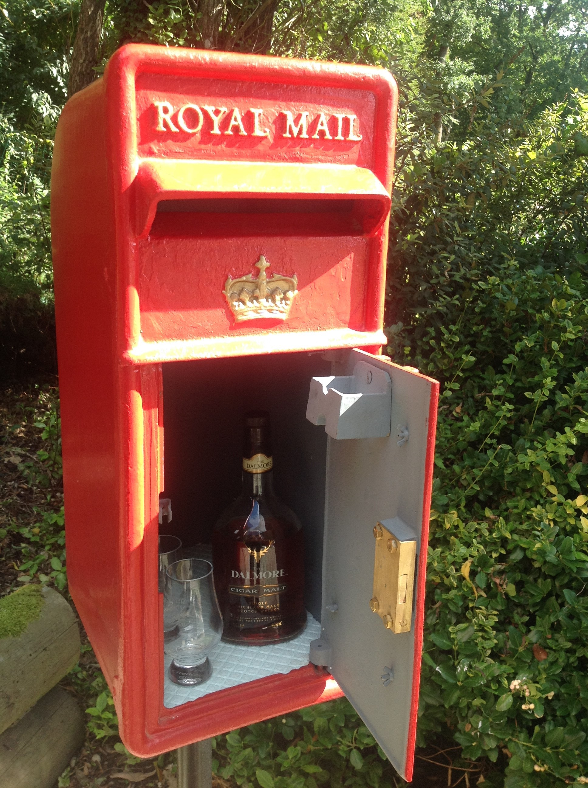 Buy antique Royal Mail post boxes for use in your home. Genuine old red letter boxes can be used in your home and garden. They can be used as a drinks cabinets