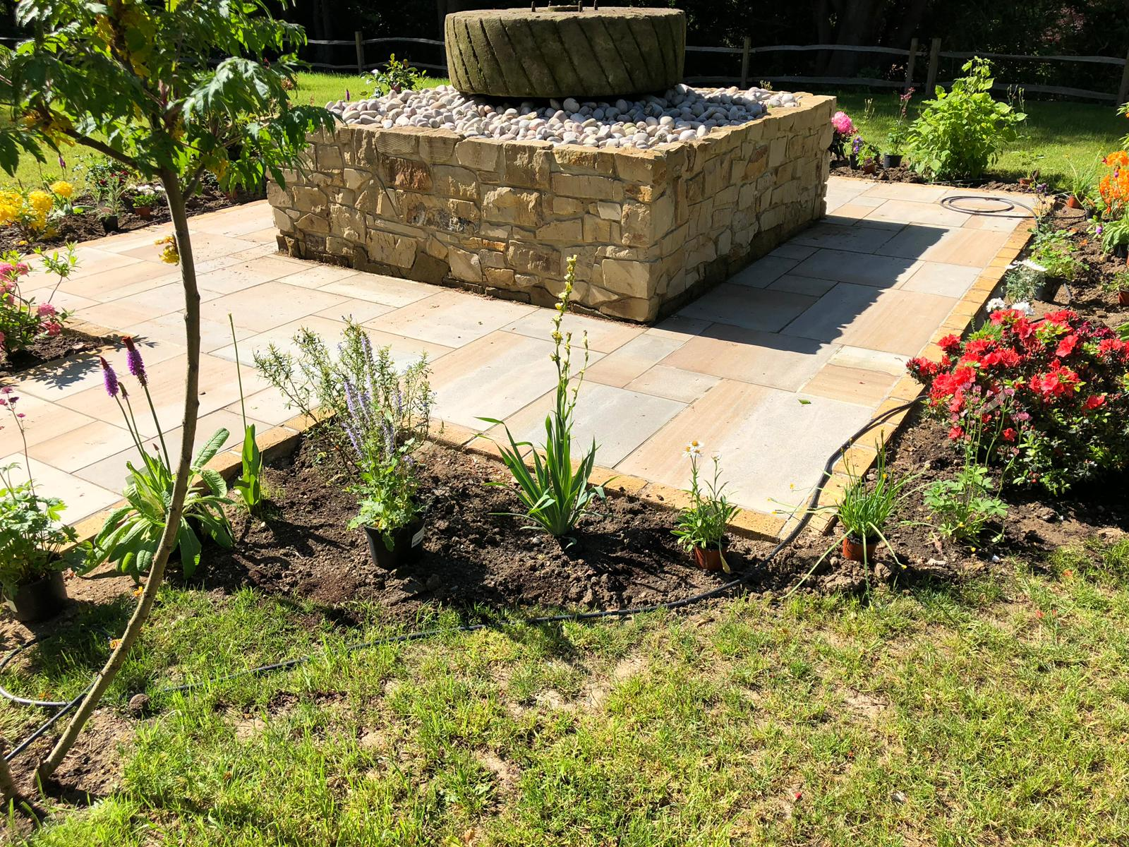 Antique Mill Stone used as a water feature in a happy customers home