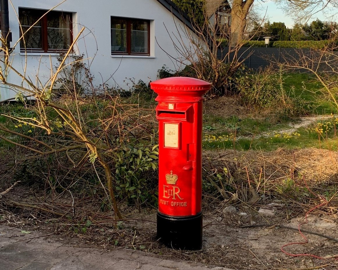Original Royal Mail Pillar Box Fitted In a Happy Customers Come in Germany. UKAA Can Deliver Antique Pillar Boxes and Post Boxes Worldwide. Read more