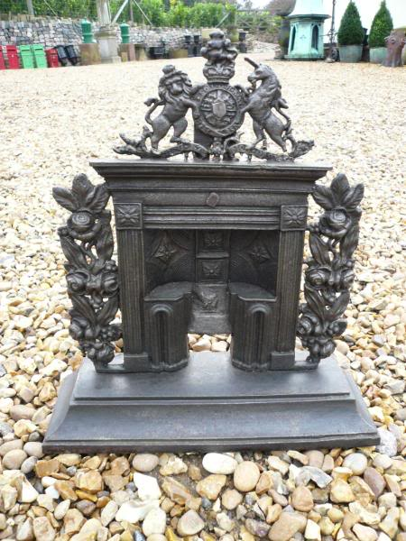 Original antique salvaged miniature salesman samples of cast iron fireplaces in ornate designs are for sale in our warehouse in Staffordshire