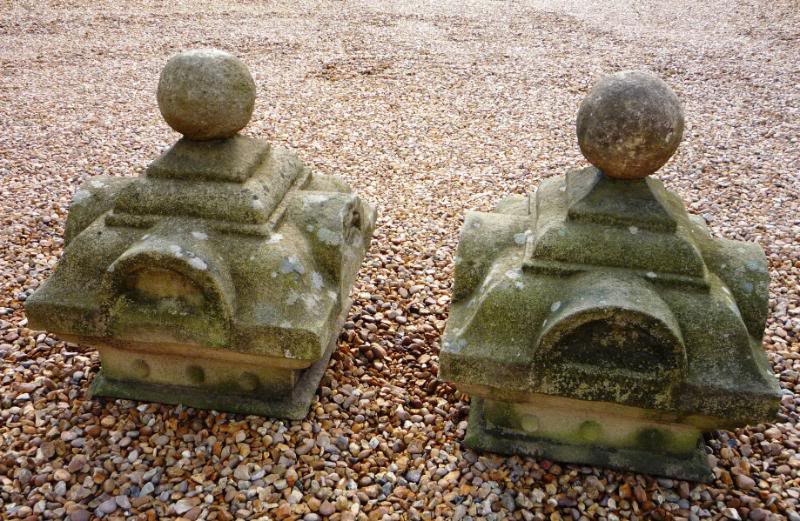 Antique original weathered Victorian gate pier cappings made from stone and available to view in our yard