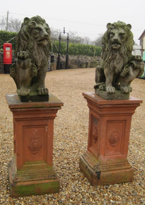 Antique original salvaged pair of armorial lions on terracotta plinths