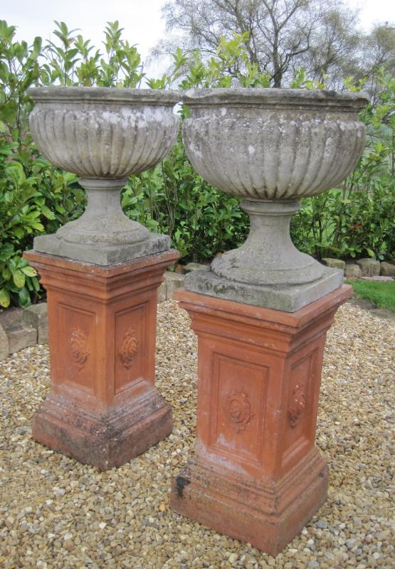 Original antique Chilstone fluted bowl urns on terracotta plinths ready for immediate delivery worldwide