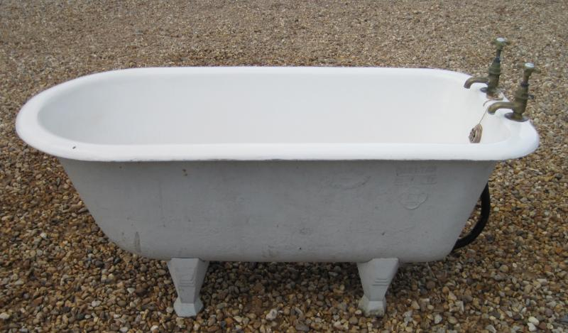 Original Victorian bathrooms freestanding small children's cast iron bath with an enamel roll top suitable for old traditional bathrooms