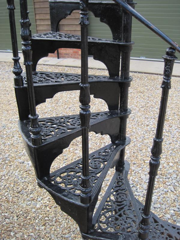 Antique reclaimed cast iron spiral staircase with landing