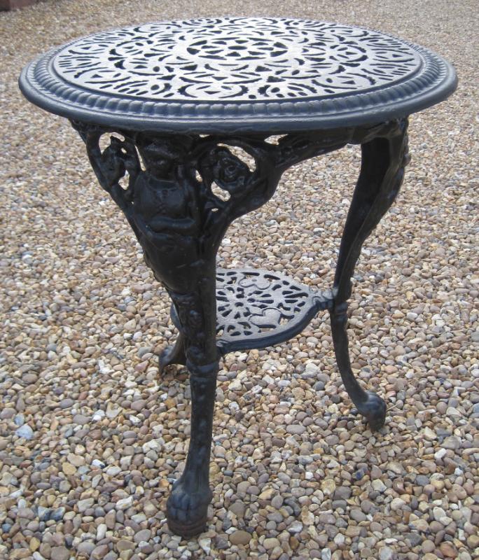 A Vintage Salvaged Cast Iron Garden Round Table