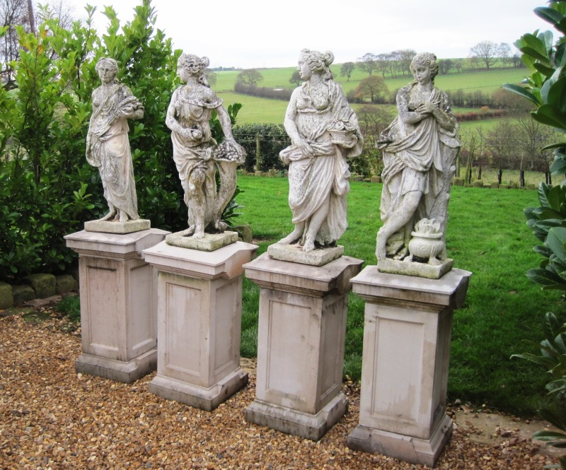 Antique aged Victorian 4 seasons statues spring, summer, autumn and winter available to view in our yard