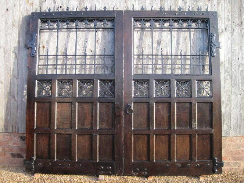 British made original antique reclaimed solid oak gothic driveway gates with metal detailing fully refurbished  in our workshops and ready to be fitted