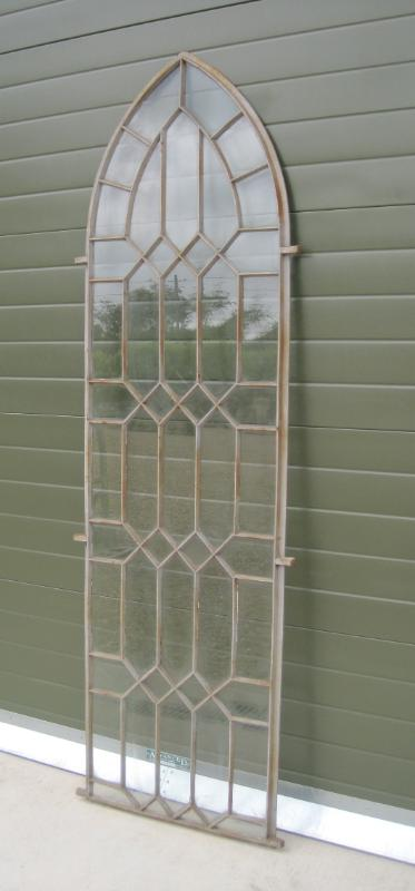 Reclaimed original antique coalbrookdale cast iron window frames in an arched design suitable for old Victorian, Edwardian and Georgian properties