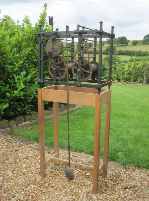 Antique Victorian wrought iron turret clock movement on stand in our showroom