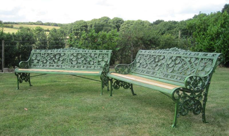 Original antique salvaged coalbrookdale cast iron gothic pattern garden benches fully refurbished ready to view in our yard