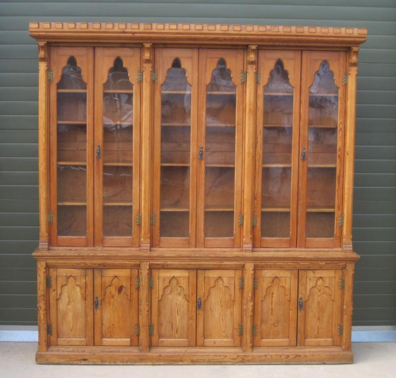 Original pitch pine gothic book case salvaged from a property in the UK fully refurbished in our workshops and delivery for collection or delivery