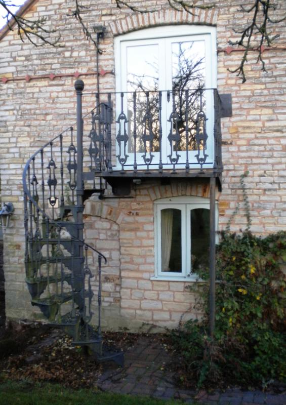 Picture Of An Antique Spiral Stair case fitted outside with a Balcony