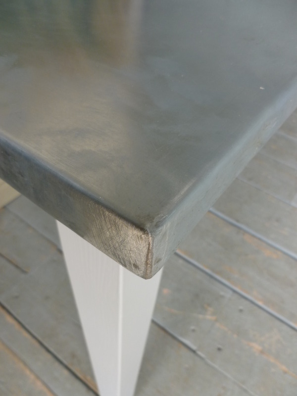Close Up Of Natural Zinc Table Top Soldered Corner