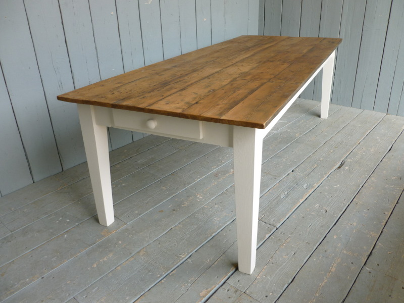 Antique reclaimed pine floorboards made into a dining table in your bespoke sizes are made in our British workshops