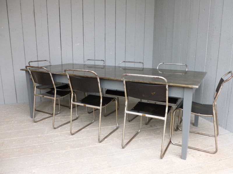 Personalised vintage style metal top table made from zinc with industrial stacking chairs ready for delivery worldwide