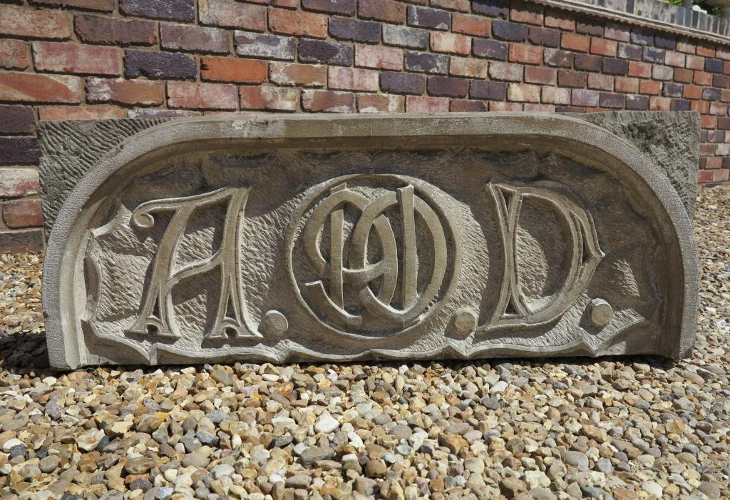 Hand carved buff coloured date stone
