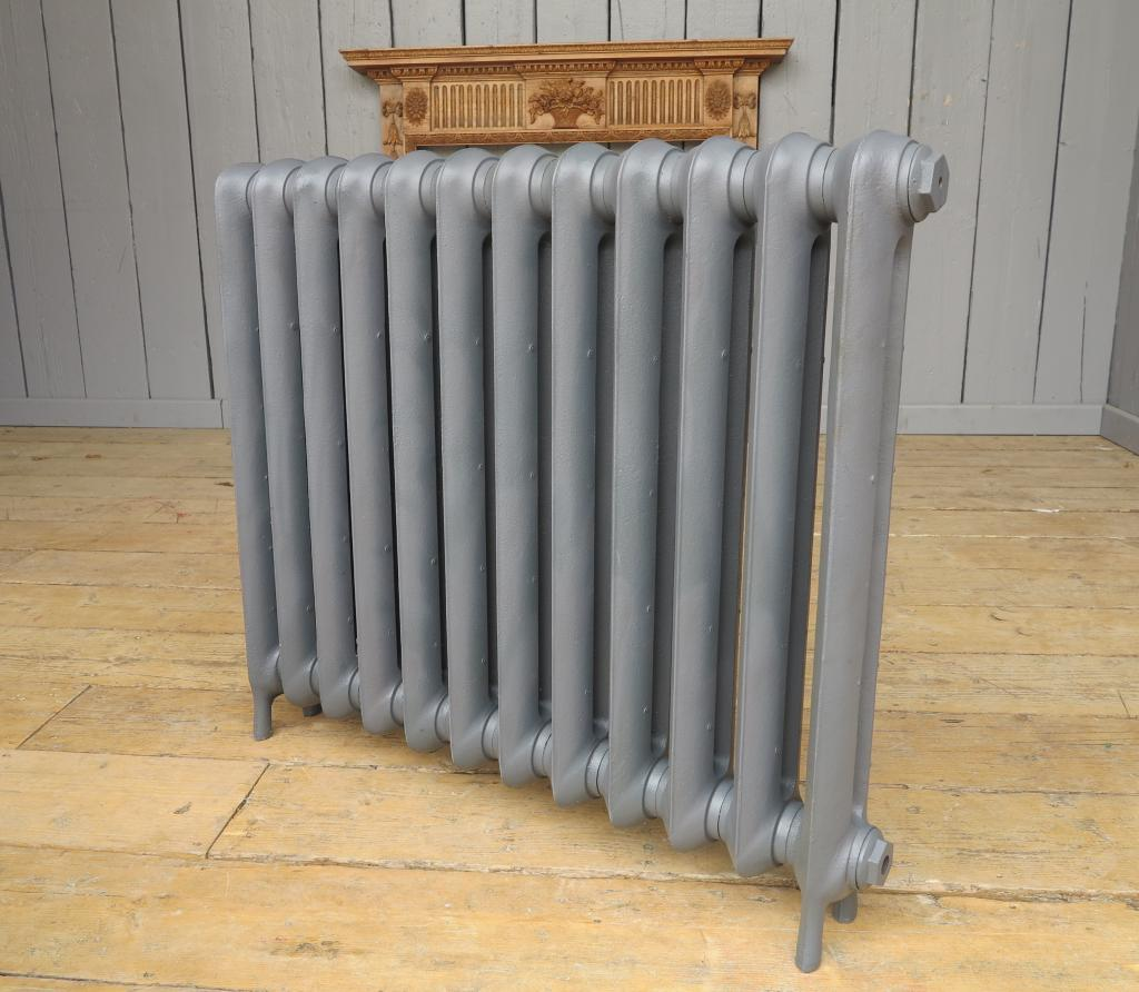 Carron cast iron radiators to go in a primer finish ready to be delivered or collected from our radiator shop