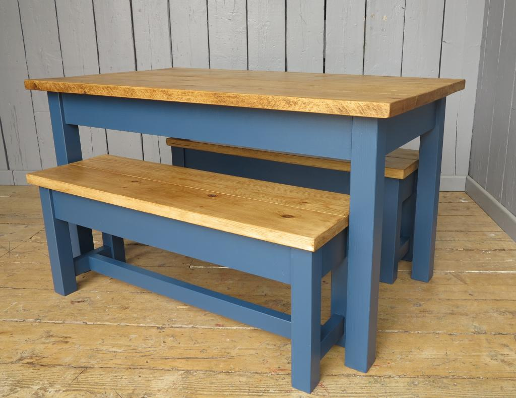Traditional farmhouse style plank top table with matching benches British made using reclaimed pine in your size available to view in our showroom