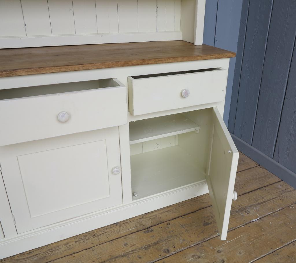 Any size made reclaimed pine dresser with glass doors painted in little greene available to view in our warehouse