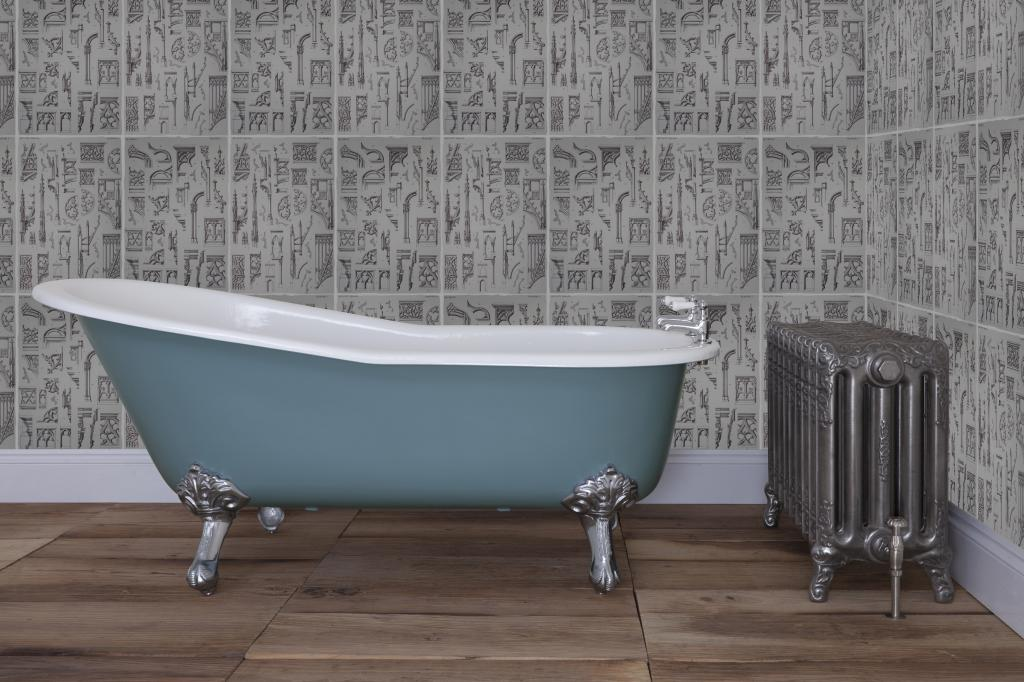Traditional Victorian cast iron single slipper roll top baths with clean enamel inside and a painted exterior with antique style ball and claw feet.