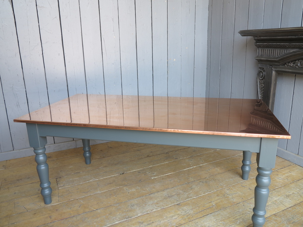 handmade bespoke copper tables available to order at UKAA with a wooden painted base ideal for restaurants pubs and bars