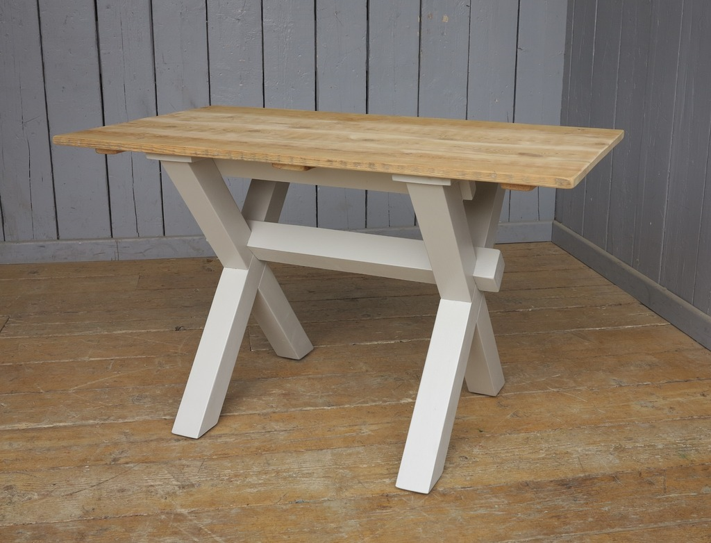 bespoke handmade chunky X frame table with a reclaimed Victorian floorboard waxed top British made here in our workshops to your sizes available for delivery