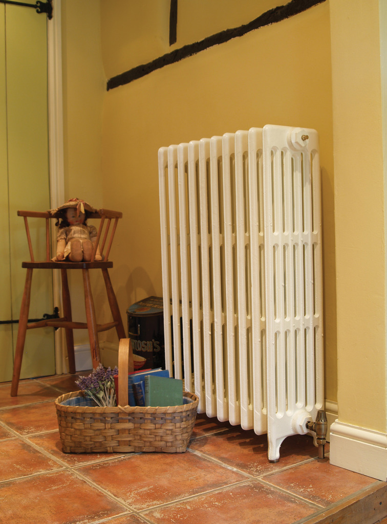 The BTU calculator might recommend a large cast iron radiator