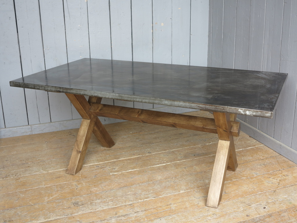Chunky rustic X frame table made from reclaimed pine with a industrial natural zinc top bespoke made to your specific sizes here in our workshops