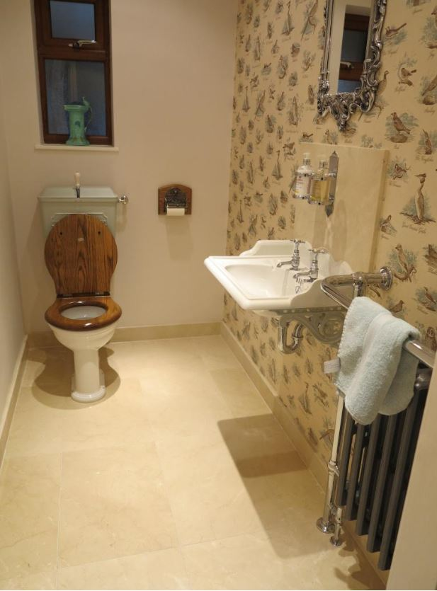 Thomas Crapper low level cast iron cistern and white china wash basin set on brackets available for a next day delivery