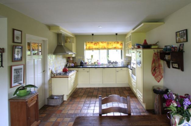 Antique original terracotta quarry tiles fitted in a farmhouse kitchen