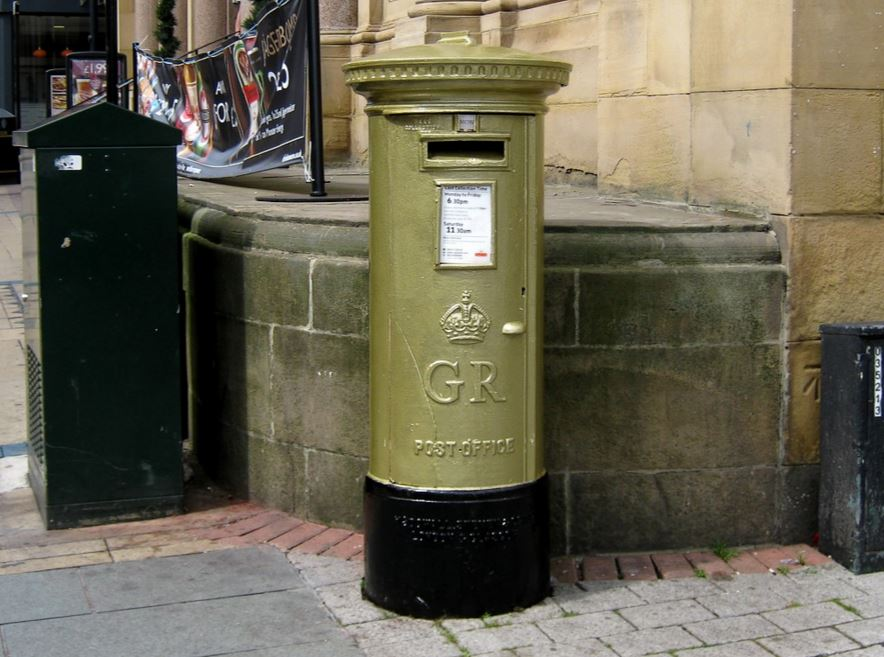 Original antique pillar boxes painted gold for the medal winners at the olympics