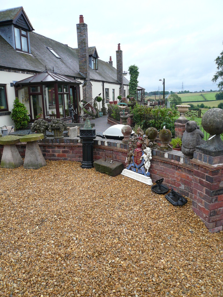 Original antique garden statues, planters, tables and chairs are available to view in our yard