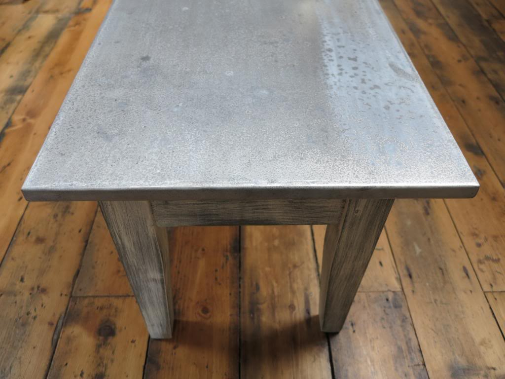 Looking down the top surface of the Distressed Antique Zinc Table
