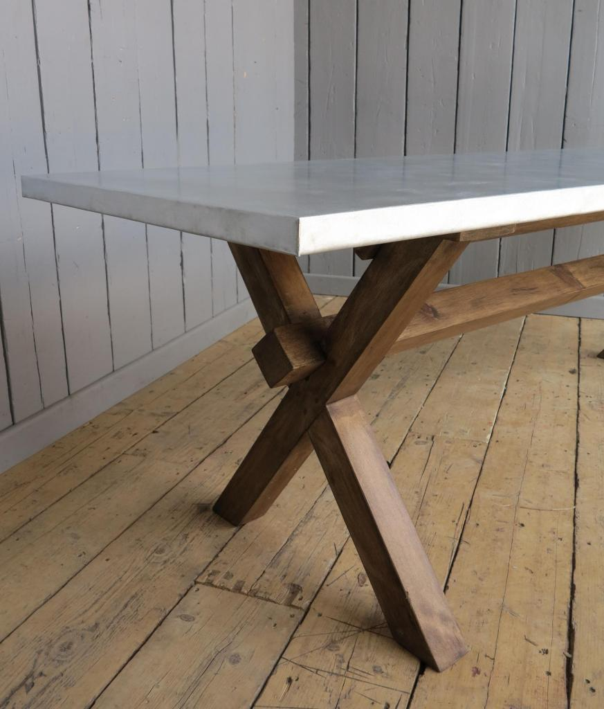 Side view of the Cross Base Bespoke Table with Matt Zinc Table Top