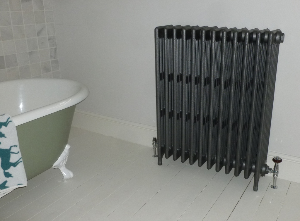 Hidden rear radiator wall stays made for Carron radiators suitable for original reclaimed school radiators available for delivery worldwide